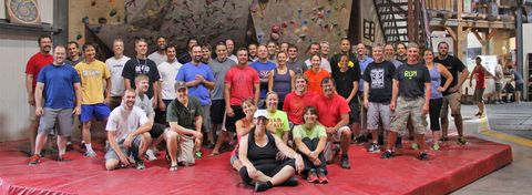 Group learning to rock climb at Petra Cliffs in Burlington Vermont